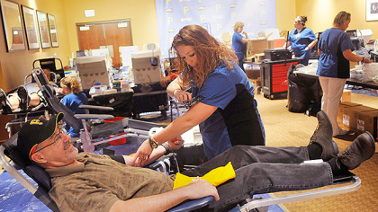 002.jpg Shannon Davis, a phlebotomist with the Central Blood Bank, prepared John Noe of the North Side to donate blood at a blood drive co-sponsored by the Pirates at PNC Park.