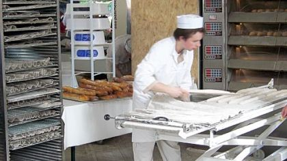 A baker makes baguettes A baker makes baguettes at la Fete du Pain, the annual Festival of Bread in Paris.