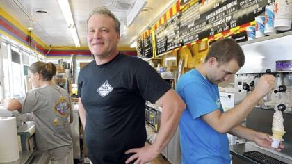 "A ""happy business"" Chuck Page, owner of Page's Dairy Mart, says, ""This is a happy business."" Four generations have helped run the ice cream stand, at East Carson Street and Becks Run Road, since 1951."