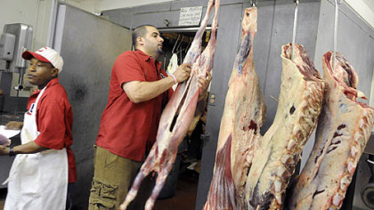 Abdullah Salem hangs a goat Abdullah Salem hangs a goat next to beef at his family's business, Salem's Halal Meats & Groceries, in Oakland.