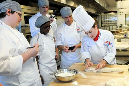 Amanda Flesch Chef Amanda Flesch, right, shows students in her baking and pastry class how to make soft rolls at the American Academy of Culinary Arts at Pittsburgh Technical Institute in North Fayette.