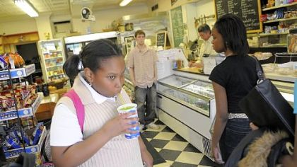 An after-school place to go Tyler Randolph, 11, stops in at the Frick Park Market on the way home from school to drink a lemon-lime slushie.