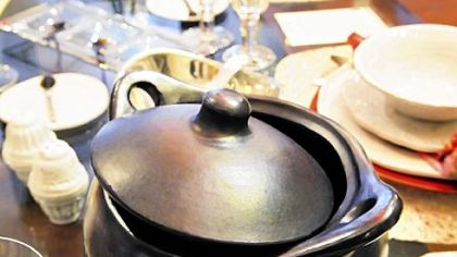 Annex Cookery, Homestead A black clay cooking pot joins other ware in a tabletop display at Annex Cookery. The black vessels, straight from tepee-shaped kilns in Colombia, can be used in the oven, on the stovetop, in the microwave and on the table.
