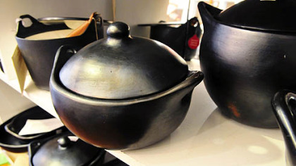 Annex Cookery, Homestead Various types of black clay cooking vessels sit on shelves inside the Annex Cookery store in Homestead.
