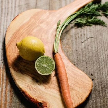 Bandy board Pittsburgh-made cutting board by Chris Bandy with veggies on it.