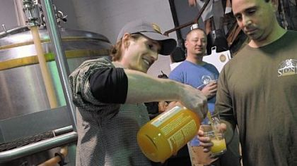 Beer pourer Joe Green, a volunteer with East End Brewing Co., pours a beer for Adam Cratty of Oakmont.