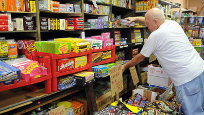 Bill McCoy at Fort Pitt Candy Bill McCoy of McKeesport, straightens the shelves piled with candy at the Fort Pitt Candy Company in the Strip.