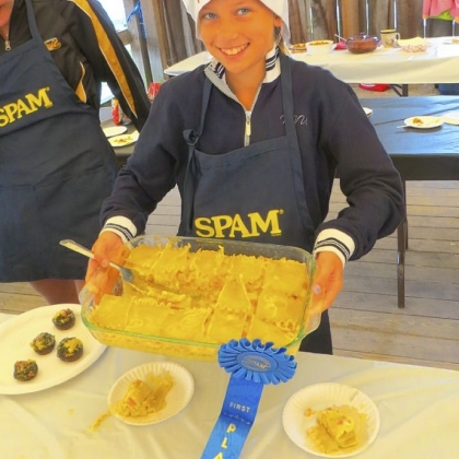 "Carly Terensky Carly Terensky, 11, who lives near Avella, Washington County, poses with the ""SPAM-ashed"" casserole that won her a blue ribbon at the Washington County Fair."