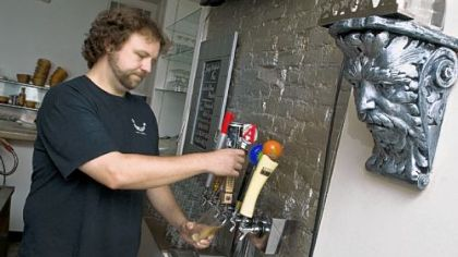 Chef Adam Manculich Chef Adam Manculich pours 21st Amendment Back in Black IPA, one of the beers on tap at Yo Rita on the South Side.