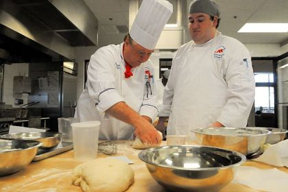 Chef Norman Hart Chef Norman Hart helps student Seth Mayo with his dough.