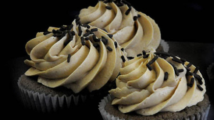 "Chocolate peanut-butter cupcakes Chocolate peanut-butter cupcakes in the showcase at ""Sweet Tammy's."""