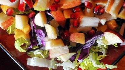 Chopped Autumn Salad with persimmons and pomegranates Chopped Autumn Salad with persimmons and pomegranates.