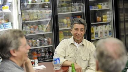 Co-owner John Prodan Co-owner John Prodan chats with customers inside the Frick Park Market in Point Breeze on a recent Friday.