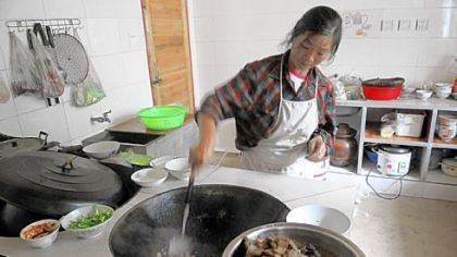 "Cook with 2 woks ""Our host in China used two large woks to cook lots of different types of food for us,"" writes Chloe Mellon, 12, of Emsworth."