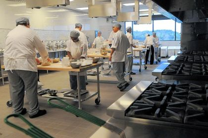 Culinary students Culinary students practice rolling bread dough at the new school.
