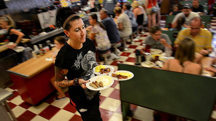 delucas Lori Robinson serves up breakfast at DeLuca's in the Strip District.