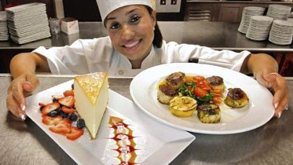 Elise Wims Andora Restaurant executive chef Elise Wims with her signature dish (right), Pesto Seared Scallops, with Sauteed Chard and roasted Cemuy tomatoes, in a Shallot Burerre Blanc. For desert (left), New York Colossal Cheesecake with fresh berries and Carmel-Raspberry Sauce.