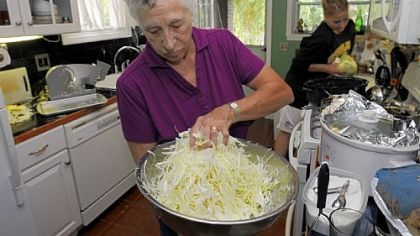 Freda Vogelsberger Freda Vogelsberger mixes in the salt. Three tablespoons of canning salt to 5 pounds of cabbage is a good ratio. Dana Tabay, of New Brighton, cuts cabbage in the background.