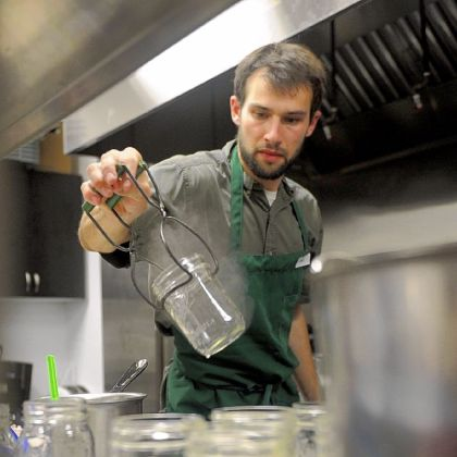 Gabe Tilove Gabe Tilove removes empty canning jars from a boiling pot in the Earthen Vessels Outreach community kitchen. He's one of the founders of the Pittsburgh Canning Exchange.