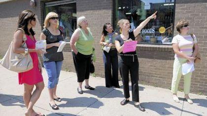 Guide Sylvia McCoy along Penn Avenue Tour guide Sylvia McCoy points out points of interest along Penn Avenue.