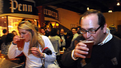 Kathi Hursh and Eric Schumann Kathi Hursh, left, of Sewickley, and Eric Schumann, of Ross, sample beers yesterday during the re-opening party for Penn Brewery on the North Side.