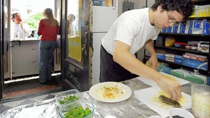 Kubideh Kitchen At the Kubideh Kitchen, Angel Gonzalez prepares kubideh sandwiches, an Iranian dish of spiced ground beef served with fresh basil, mint and onion on homemade Barbari bread with black sesame seeds.