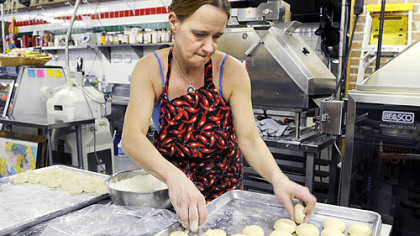 Linda Jones makes tortillas at Reyna Foods Linda Jones dips dough balls in flour before a machine flattens them into warm tortillas at Reyna Foods on Penn Avenue in the Strip District. Reyna recently started making its own corn and wheat-flour tortillas.