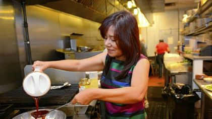 Ling Robinson Ling Robinson prepares Queen Tilapia at the Green Mango in Monroeville.