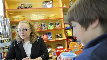 Maggi Cook, owner of Frick Park Market Maggi Cook, owner of the Frick Park Market in Point Breeze, takes orders for candy and slushies at the candy bar on a recent Friday.