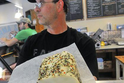 Mangalitsa lardo Casey Romig at Parma Sausage Co. displays Mangalitsa lardo.