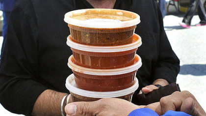 Market Square farmers market salsas Sunny Dhingra of Springfield, Ohio, checks the salsas he bought today at Cinco de Mayo Salsa at Market Square. Mr. Dhingra and his family are in Pittsburgh for the international science and engineering fair.