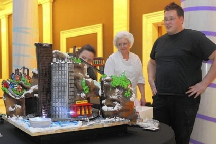 "Megan Hart, left, Alice Leich and Patrick Ellis Megan Hart, left, Alice Leich and Patrick Ellis look at ""It's a Delicious Day in the Neighborhood!,"" an edible cake made for CAKEitecture, Heinz Architectural Center's 20th anniversary celebration, at Carnegie Museum of Art on Saturday. Dozen Bakeshop, where Ms. Hart is head cake designer and Mr. Ellis is assistant cake designer, teamed up with the Young Architects Forum to create their Mr. Rogers' Neighborhood-themed cake."