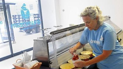 Naomi Herman Naomi Herman, a volunteer for the American Liver Foundation, dishes up red velvet ice cream at Dream Cream, a pop-up ice cream store on Liberty Avenue, Downtown.