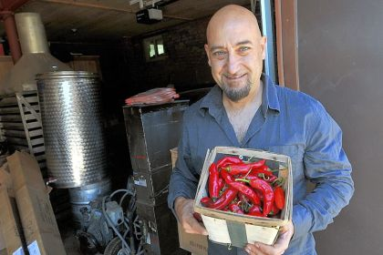 Nick DiCio Nick DiCio, of Reyna Foods, displays a basket of chiles grown locally from Hatch seed.