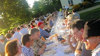 Outstanding in the Field's dinner Diners crowd the long table at Outstanding in the Field's dinner at Kinnikinnick Farm in Caledonia, Ill., last Aug. 25.