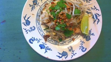Pad Thai Phurit Saengthong-aram's Pad Thai, garnished with crushed peanuts, cilantro and a wedge of lime.