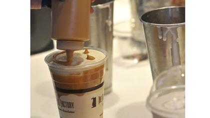 Peanut butter/cookie dough milkshake Peanut butter/cookie dough milkshake gets a peanut butter smiley face.