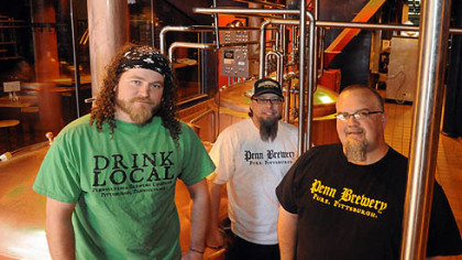"""Penn Brewery brewers Penn Brewery brewers -- Nick Rosich (left), Steve Crist and Andy Rich -- model the brewery's new """"Drink Local"""" shirts (on sale there for $15), as well as their brewer's beards (not for sale)."""