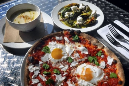 Pizza with sunny-side-up eggs At Dinette in East Liberty: pizza with sunny-side-up eggs, parsnip cream soup, and grilled shishito peppers.