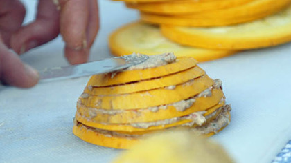 Preparing a Summer Stack with squash Laura Miller prepares a Summer Stack, squash layered with olives and goat cheese.