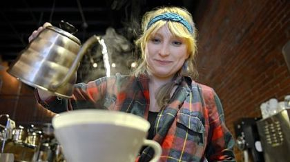 Rachel Grozanick Rachel Grozanick brews a cup of Kenyan coffee at 21st Street Coffee and Tea in the Strip District.
