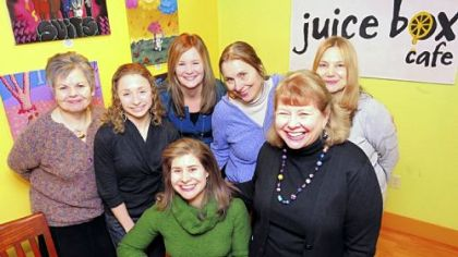 Rebecca Gilbert, seated Rebecca Gilbert, seated center, with her mom, Shandel, right, and other diners at the Juice Box Cafe in Shadyside.