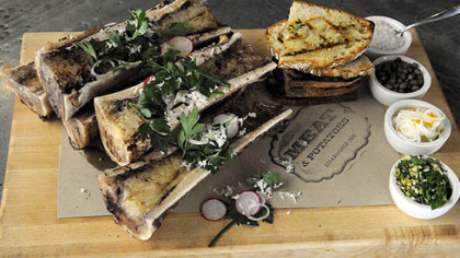 Roasted bone marrow Roasted bone marrow with grilled breads and from top right, sea salt, capers, pickle onion and gremolata by Richard DeShantz of Meat & Potatoes on Penn Avenue, Downtown.