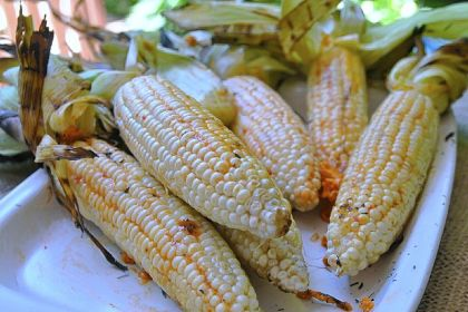 Roasted corn with red pepper butter Roasted corn with red pepper butter.