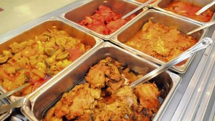 Salem's Grill Hot prepared foods at Salem's Market & Grill in the Strip District include, from left in the back row, vegetable curry, tandoori chicken and chicken curry, and from left in front, barbecue chicken, roast chicken and lamb curry, plus rice.