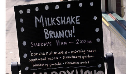 Sign in front of The Milk Shake Factory Sign in front of The Milk Shake Factory on Carson Street announcing milkshake brunch.