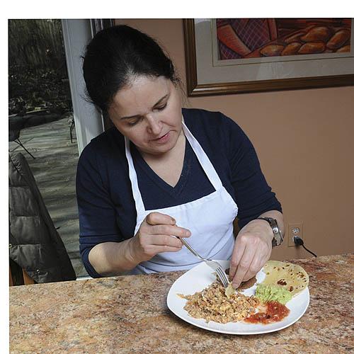 Silvia de los Santos de Dooley Silvia de los Santos de Dooley serves her tortillas de harina with machacado con huevo, frijoles refritos, aguacate, and salsa.