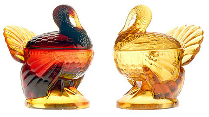 "Smith Glass turkeys Turkeys made by L.E. Smith Glass of Mount Pleasant, Westmoreland County, come in several colors. At left, the new ""amberina"" turkey has a red body and amber tail. At right, the amber bird, which faces competition from foreign imports."