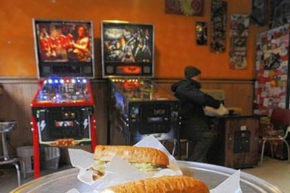 "Spak Bros. Seitan Pittsburgh ""Steak"" foreground and the Seitan Buffalo Melt at Spak Bros. in Garfield"