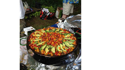 Texas Paella A Texas Paella that includes meat, beans, rice and chilies.